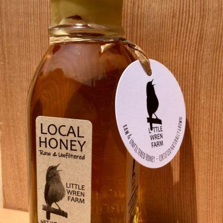 8 oz Muth jar filled with Little Wren Farm raw honey